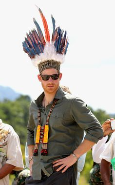 Prince Harry Photos Photos - Prince Harry is presented with a headdress by dancers in Sumara Village in the Guyana Hinterland on day 13 of an official visit to the Caribbean on December 3, 2016 in Sumara, Guyana. Prince Harry's visit to The Caribbean marks the 35th Anniversary of Independence in Antigua and Barbuda and the 50th Anniversary of Independence in Barbados and Guyana. - Prince Harry Visits The Caribbean - Day 13