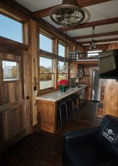 With burl wood cabinets, leather armchairs, granite countertops, a beaten copper sink and a marble bathroom.#TinyHouseforUs
