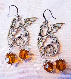 Dragon earrings of antique silver; 2 autumn orange Swarovski crystals on each earring; dragon jewelry; Swavrovski crystals