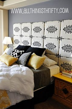 I want to do a headboard like this using square boards with fabric...inspiration!