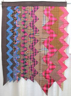 Plaid One by Eleanor Dugan. Quilted by Dani Lawler.  2014 Voices in Cloth, photo by The Plaid Portico
