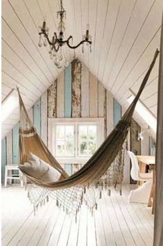 I want an attic... with a chandelier... just so I can hang a bohemian hammock in it :)