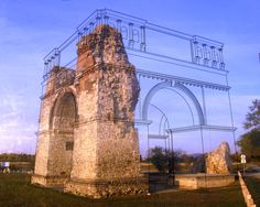 An outline overlay reconstructs the damaged Heidentor, a 4th century AD roman victory monument in Austria