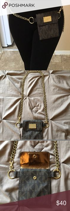 Micheal Kors belted pouch -Dimensions: 5.25 x 4.5 (L x W) inches -Gold accents -Meant to be worn as belt (shown in photos) but can be worn on the shoulder as well! -Chain length: 25 inches Michael Kors Accessories Belts