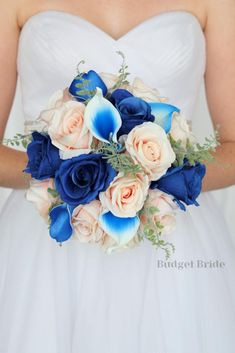 This is a round bouquet with royal blue roses, peach roses accented with royal blue halo calla lilies and greenery Budget Bride, Blue Wedding Flowers, Calla Lilies, Blue Roses, Bride Bouquets, Coral Color, Beautiful Bride, Greenery, Halo