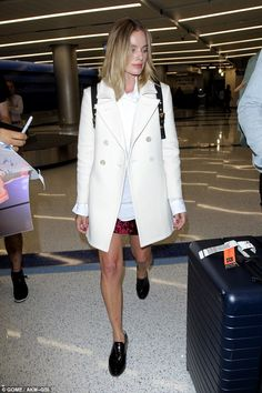 Stylish: The Hollywood starlet was dressed for unpredictable weather in a crushed red velv...