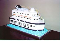 Cruise Ship - This cake was for a bridal shower.  The couple was cruising on their honeymoom.  I was given a picture of their cruise ship to duplicate.  I used an 11x15 and 9x13 cut and stacked