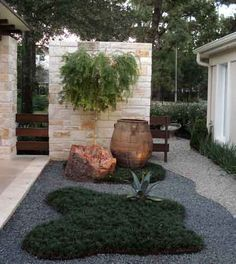 """Zen gardens are very unique landscaping designs that are also known as """"Japanese Rock Gardens."""" .   I like how the different gravels define the path.CB"""