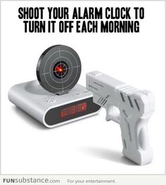 Gun and target alarm clock. I want one.