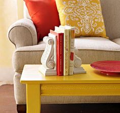 Simple Scrolls  Mismatched, painted corbels from a home center are easy to convert to bookends.  Visit the post at Better Homes and Gardens