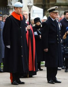 Prince Philip, Duke of Edinburgh, accompanied by Prince Harry (L), visits the Field of Remembrance at Westminster Abbey, London, UK, on 07.11.13.