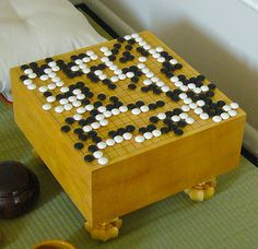 The ancient game of Go, Wei-chi, or Baduk depending on where you are from.  An addictive pastime.