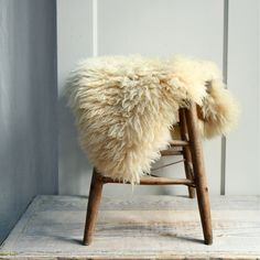 a nice vintage sheepskin pelt in creamy off white perfectly sized for a chair or stool.even a small area rug soft and warm, with nice scandinavian style approx 26 x 18 c o n d i t i o n clean with no rips, stains or odors