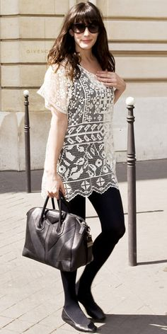 Liv Tyler exited her Paris hotel in a lace tunic over leggings accented with a structured Givenchy tote and leather flats.