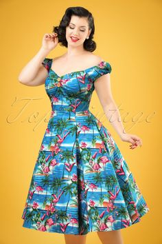 This 50s Dolores Flamingo Island Doll Dressis a real summer favourite, it's not hard to see why!Top in carmen style, cute puffy sleeves which can be worn off-shoulder, a full swing skirt and pleats at the bust for a beautiful cleavage, wow!And then we didn't even mention the fantastic print of flamingos resplendent on a background of perfect blue seas and sandy beaches with palm trees... she'll brighten up any day.Made from a firm yet suppl...