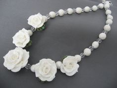 "The roses and beads for this 18"" necklace were made from cold porcelain.  $45.00"