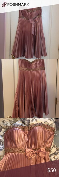 Dusty pink homecoming dress Worn once. No flaws other than some minimal problems with the beading. Seen in photo. alyce designs Dresses Strapless