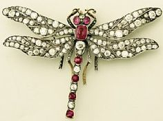 Antique dragonfly brooch | A stunning, fine and impressive antique 5.7 carat diamond and 3.30 carat ruby, 9 carat yellow gold dragonfly brooch.