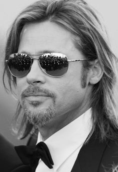 Brad Pitt captured at Cannes. The quintessential Cannes Red Carpet 'Movie Star' shot.
