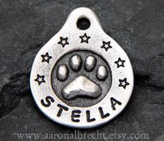 Pet Tag Dog Tag Pet ID Dog Tags for Dogs Pets Accessories Custom Paw Print by aaronalbrecht on Etsy Custom Dog Tags, Personalized Dog Tags, Dog Tags Pet, Hand Stamped Metal, Animal Room, Dog Pin, Pet Id, Dog Accessories, Metal Stamping