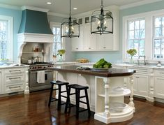 I like the little cabinets up near the ceiling with the glass on the front. The area above the stove is very cool too.