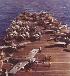 Grumman F4F-4 Wildcat fighters and Douglas SBD Dauntless dive bombers aboard USS Wasp (CV-7), probably in July–September 1942.