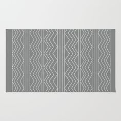Chic grey patterned rug for grey decor lovers. From $28.00. Pick clicking on link -  matching accessories - pillows, blankets, duvets. Using 100% woven polyester, these premium quality area rugs boast an exceptionally soft touch and high durability. Available in three versatile sizes (2' x 3', 3' x 5', 4' x 6') they are the perfect accent to any room in your home, featuring thousands of designs from your favorite artists on a subtle chevron pattern. Machine washable; non-skid pad not…