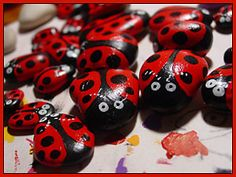 "painted rocks: ladybug painted stones - great for ""hide and seek"" games in the back yard ... any time someone finds it, they get to move it :D"