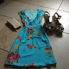 Floral Dress by Guess Jeans Beautiful form fitting lace floral dress with ruffled collar. Ties at waist. Worn twice. The dress measures 37 inches. Guess Jeans Dresses