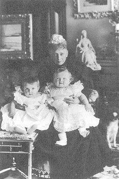 "The woman with Baby Grand Duchess Olga Nicholaievna is Queen Louise of Denmark (Nicholas II""s grandmother and Empress Marie Fyodorevna's mother) the baby is Nicholas' first cousin Princess Margareite of Denmark (daughter of his uncle Prince Waldemar of Denmark and his wife Princess Marie of Orleans)"