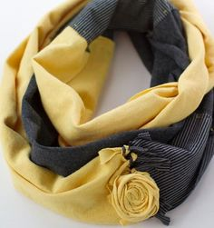 Such a pretty infinity scarf. Love the colors, the tied fringes, and the rolled rose!