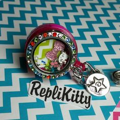 Super cute badge locket for work!  Great for nurses or anyone with an ID name badge!  Clips right on!  No need for lanyards or other parts!  Just clip and go!  Open the locket to change out the charms, and add custom charms to your set!  Order yours now at www.replikitty.etsy.com #nurse #hospital #doctor #badge #idtag #hellokitty #bling #bow #color #work #office #dream #star #chevron #neon #rainbow #color #crystal #pink #graduate #student #school
