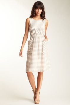 "Steven Alan   Piper Dress  Let the summer breeze graze your back in this sweet cutout style.  - Round neckline  - Sleeveless  - Tie back with cutout design  - Drawstring waist with tie back  - Slouch front pockets  - Gingham print  - Approx. 43"" length  $235.00"