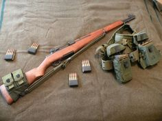 M1 Garand, en bloc clips, and repurposed mag pouches.
