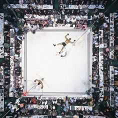 """""""Ali - Williams (Overhead)"""" by Neil Leifer - aerial of Muhammad Ali victorious after his round two knockdown of Cleveland Williams during the 1966 World Heavyweight Title fight at the Astrodome, Houston, Texas, 14 November 1966 (Image # 1002 ) Boxe Mma, Great Photos, Cool Pictures, Rare Pictures, Neil Leifer, Der Boxer, Sport Boxing, Capoeira, Sports"""