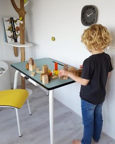 Fine colors in a boys room. Blue jade, yellow, off black and wood. Desk and chair by Les Gambettes (the middle size), paperfoam clock by Anno Benk. And on the desk the Ubikubi houses. All pieces mentioned on stock in our shop. Wood Desk, Off Black, Kidsroom, Jade, Middle, Clock, Chair, Yellow, Spring