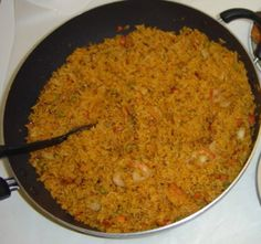 Jollof rice, also called 'Benachin' meaning one pot in the Wolof language, is a popular dish all over West Africa. It is thought to have originated in Gambia but has since spread to the whole of West Africa, especially Nigeria and Ghana Riz Wolof, Jollof Reis, Kwanzaa Food, Happy Kwanzaa, Ghana Food, Cooking Channel Recipes, West African Food, Wedding Reception Food, Wedding Menu