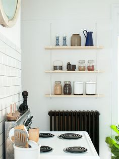 Ikea shelving brackets and boards from the lumberyard, great low cost alternative to the string shelving system I like