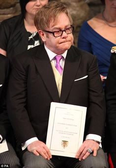 Emotional: Elton John appeared rather misty-eyed during the Royal Wedding (held at Westminster Abbey, where Princess Di's funeral was held)