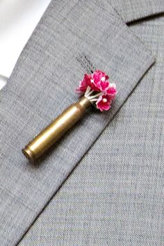 Flower bullet boutonniere for the groom.