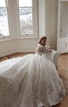 Glamorously embellished quarter length sleeve ballgown wedding dress; Featured Dress: Steven Khalil