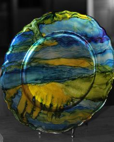 """alcohol ink on 12"""" decorative plate. Looks like watercolors"""