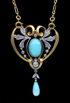 This is not contemporary - image from a gallery of vintage and/or antique objects. Art Nouveau Gold, Opal And Diamond Pendant - French  c.1900