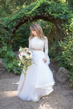 We're swooning over this two-piece wedding dress: http://www.stylemepretty.com/california-weddings/aptos/2015/09/30/modern-elegant-wedding-inspiration-at-sand-rock-farm/ | Photography: Rahel Menig - http://www.rahelmenigphotography.com/ -