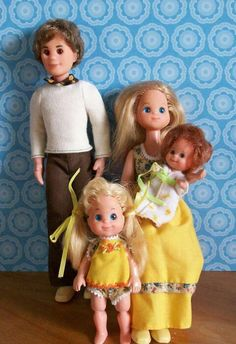 The Sunshine Family!  I loved these dolls so much.  The little girl was my favorite because of her hair.