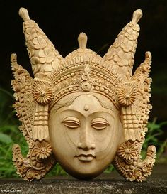 Wood mask, 'Legong Keraton Dancer' by NOVICA. Covered with frangipani blossoms, an elaborate headdress crowns a young dancer. Nyoman Subrata sculpts this extraordinary mask from crocodile wood. The Legong Keraton is probably one of Bali's most important dances.