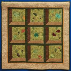"""Wall Quilt """"Falling Leaves"""" by Cheryl Willis """"I wanted to make an attractive windows quilt and decided that fall leaves would make a nice image in the windows. I tried placing and quilting the leaves to look like they are floating past the windows. Falling Leaves, Capital City, Cheryl, Autumn Leaves, Past, Quilting, Windows, Blanket, Rugs"""