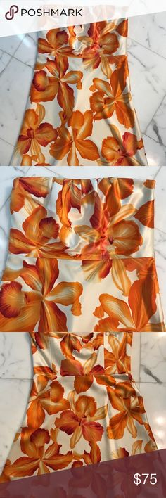Beautiful Orange Flower Dress Fabulous orange flower strapless dress. This dress will draw a lot of compliments your way! Has a little flare at the bottom for a feminine touch.   Length : 29 inches She'll: 100% Silk Lining: 100% Acetate Banana Republic Dresses Strapless