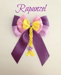 Disney inspired Tangled Rapunzel princess hair bow by BellaRayneDesigns on Etsy https://www.etsy.com/listing/201082972/disney-inspired-tangled-rapunzel