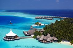 First place: The Maldives, long seen as one of the most romantic places in the world to go on holiday still stuns visitors with its crystal clear waters, white sand beaches and impossibly blue sea and sky. 'High scores across the board' from Conde Nast Traveller readers